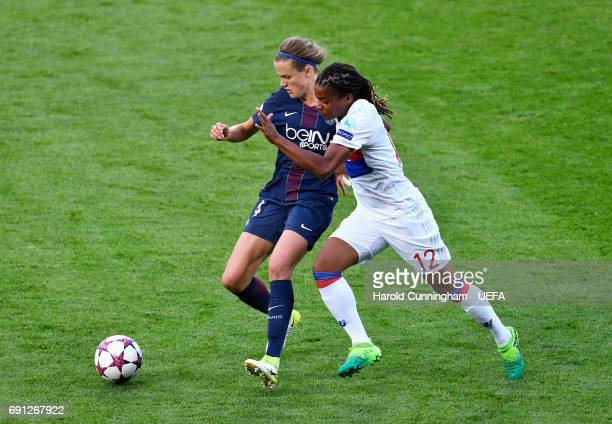 Irene Paredes of Paris SaintGermain Feminines and Elodie Thomis of Olympique Lyonnais battle for the ball during the UEFA Women's Champions League...
