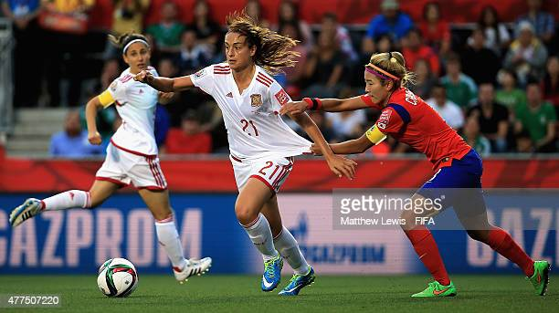 Irene Paredes of Spain and Cho Sohyun of Korea Republic challenge for the ball during the FIFA Women's World Cup 2015 Group E match between Korea...