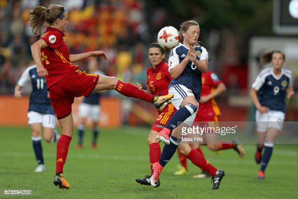Irene Paredes of Spain clears the ball while under pressure from Erin Cuthbert of Scotland during the Group D match between Scotland and Spain during...