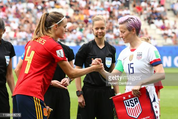 Irene Paredes of Spain shakes hands with Megan Rapinoe of the USA prior to the 2019 FIFA Women's World Cup France Round Of 16 match between Spain and...