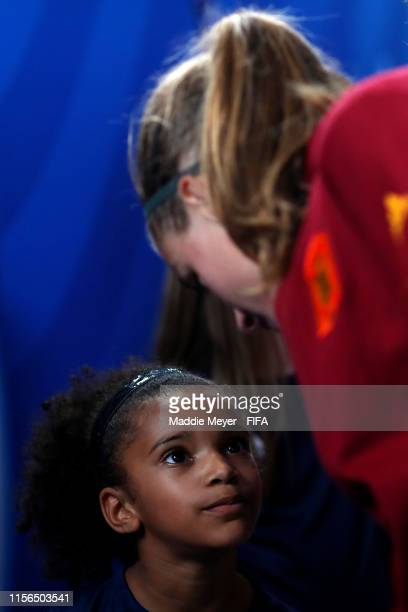 Irene Paredes of Spain speaks with a mascot the 2019 FIFA Women's World Cup France group B match between China PR and Spain at Stade Oceane on June...