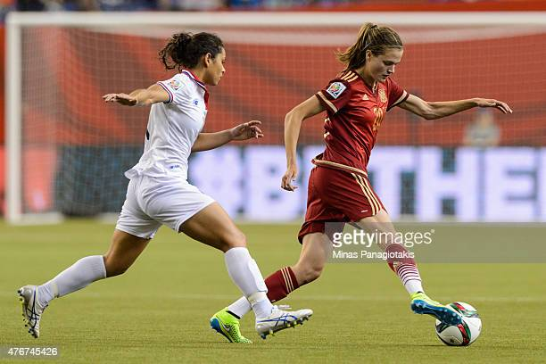 Irene Paredes of Spain tries to move the ball past Raquel Rodriguez Cedeno of Costa Rica during the 2015 FIFA Women's World Cup Group E match at...