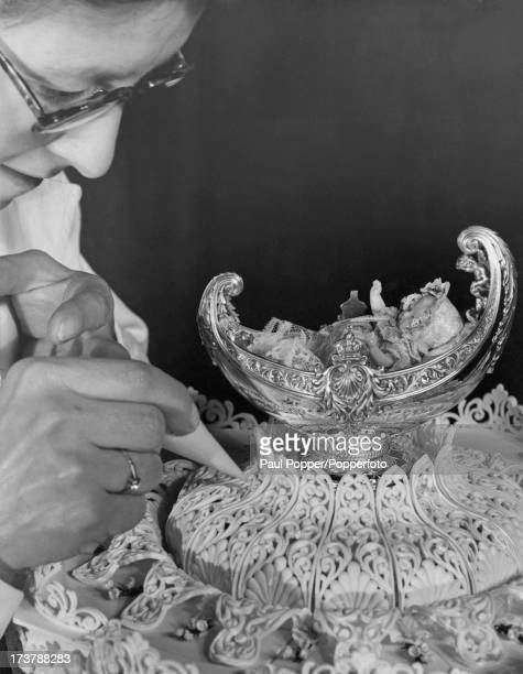 Irene Podd putting the finishing touches to the cake for the christening of Prince Charles at the McVitie and Price works in Harlesden London 9th...