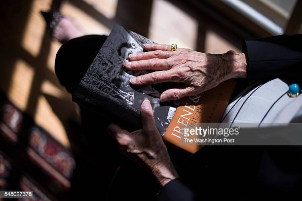 Irene Pollin widow of former Caps and Wizards owner Abe Pollin hold her book as she sits for a portrait at her home in Bethesda MD on Wednesday June...
