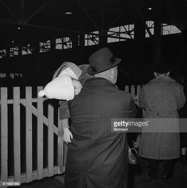 Irene Szczech sleeps in the arms of her father Stefan They await the arrival of her grandmother Anna Zieekowski who is immigrating from Poland aboard...