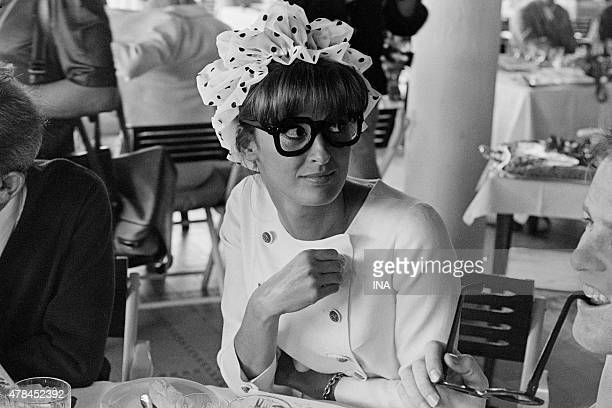 Irene Tunc in a reception with Eden Rock wearing glasses in homage to Harod Lloyd