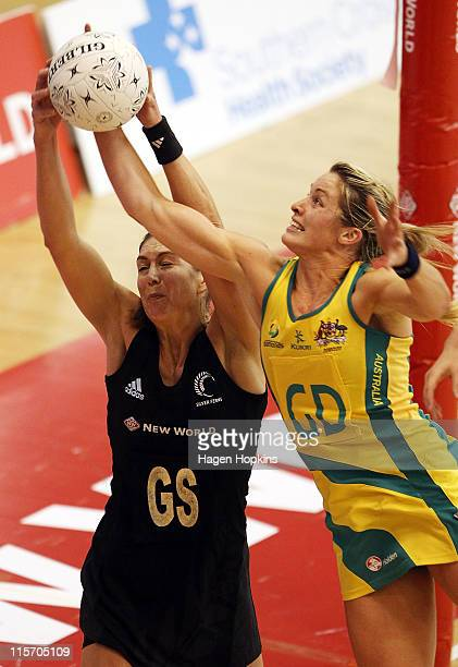Irene van Dyk of New Zealand competes for the ball with Julie Corletto of Australia during game one of the series between the New Zealand Silver...
