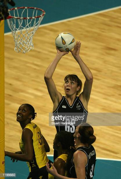 Irene Van Dyk of New Zealand shoots for goal during the Jamaica and New Zealand netball match at MEN stadium during the 2002 Commonwealth Games in...