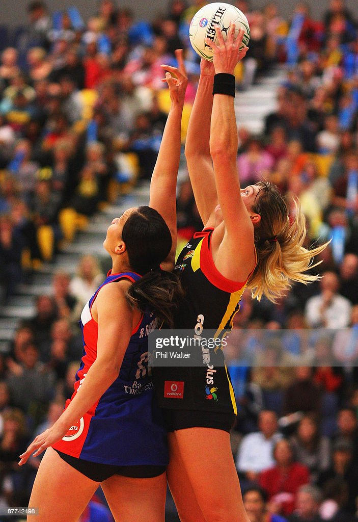Irene van Dyk of the Magic takes a pass under pressure from Racheal Rasmussen of the Mystics during the round seven ANZ Championship match between the Magic and the Mystics played at the Energy Events Centre on May 18, 2009 in Rotorua, New Zealand.