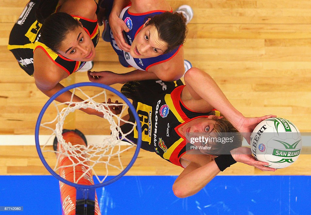 Irene Van Dyk of the Magic takes a shot at goal watched by team mate Maria Tutaia (L) and Stephanie Bond (C) of the Mystics during the round seven ANZ Championship match between the Magic and the Mystics played at the Energy Events Centre on May 18, 2009 in Rotorua, New Zealand.