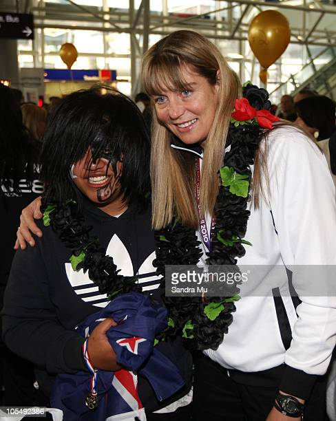 Irene van Dyk of the New Zealand Silver Ferns poses with fans as she arrives at Auckland International Airport on October 16 2010 in Auckland New...