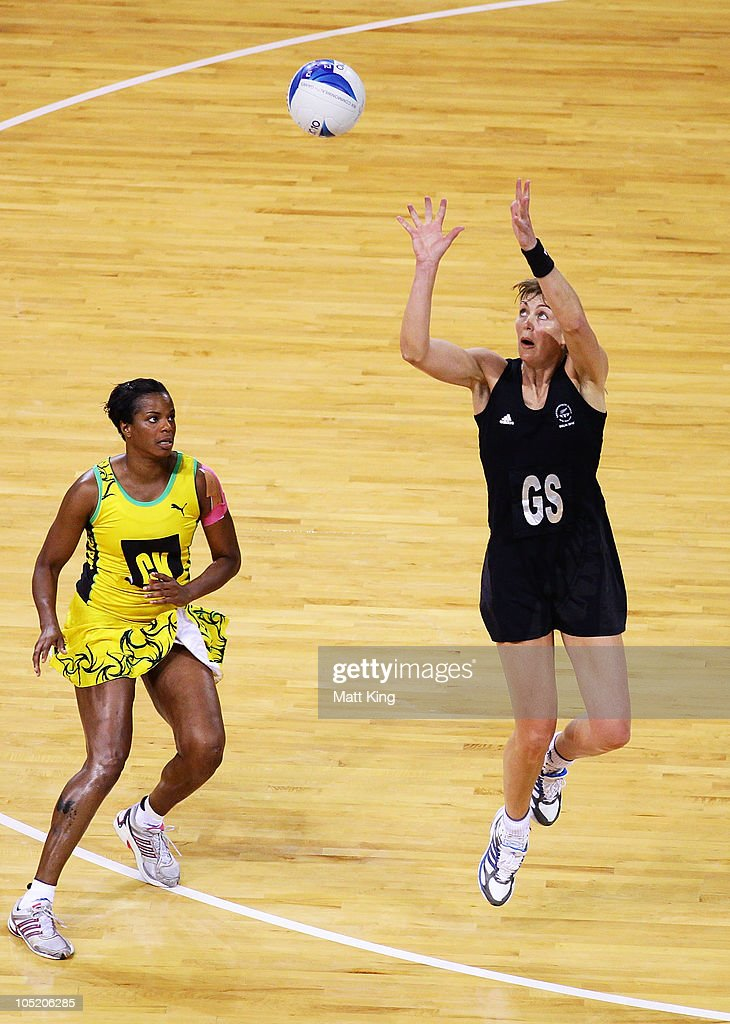 Irene van Dyke of New Zealand catches the ball in front of Althea Byfield of Jamaica during the Women Semifinals Match between New Zealand and Jamaica at the Thyagaraj Sports Complex during day nine of the 2010 Commonwealth Games on October 12, 2010 in Delhi, India.