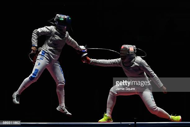 Irene Vecchi of Italy competes against Ibtihaj Muhammad of the United States during the Women's Sabre Team bronze medal match between United States...
