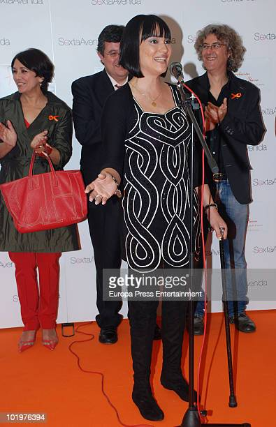 Irene Villa making a speech, Isabel Gemio and Luis Malibran during the opening of the pictures exhibition 'Mujeres al natural' organized by Sandra...
