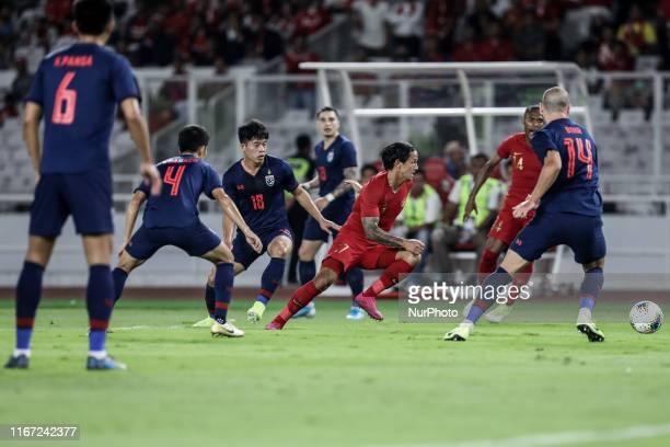 Irfan Bachdim of Indonesia's in action with Theerathon Bunmathan of Thailand's during FIFA World Cup 2022 qualifying match between Indonesia and...