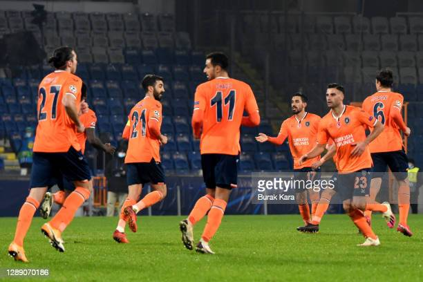 Irfan Can Kahveci of Istanbul Basaksehir FK celebrates with team mates after scoring their sides third goal during the UEFA Champions League Group H...