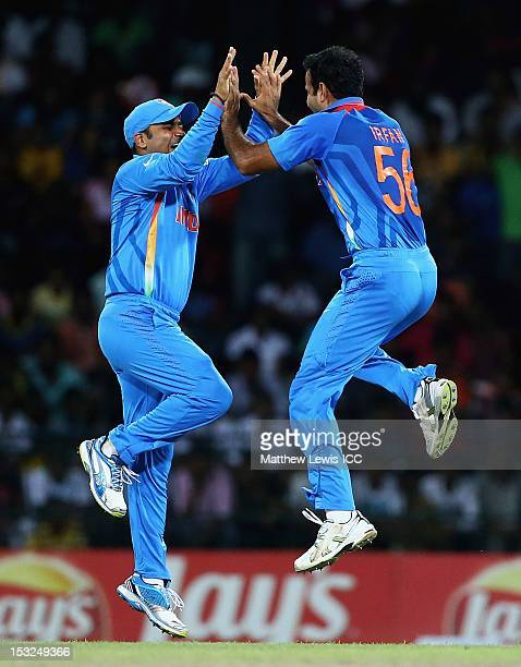 Irfan Pathan and Virender Sehwag of India celebrate the wicket of Jacques Kallis of South Africa during the ICC World Twenty20 2012 Super Eights...
