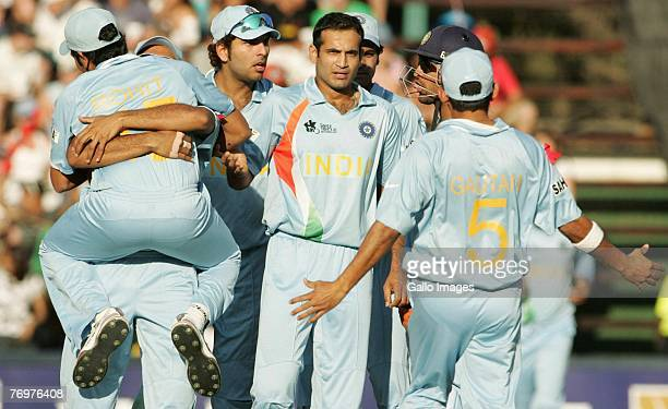 Irfan Pathan of India and his team mates celebrate the wicket of Shoib Malik of Pakistan for 6 runs during the Twenty20 Championship Final match...