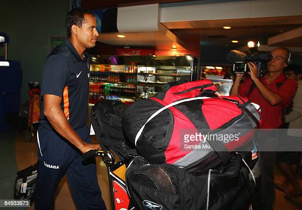 Irfan Pathan of India walks through the arrivals hall as the Indian cricket team arrive at Auckland International Airport on February 20 2009 in...