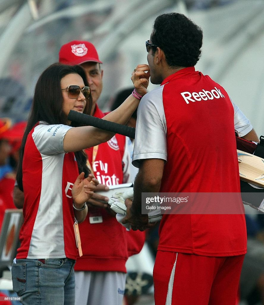 Irfan Pathan receives sweetmeats from Preity Zinta Bollywood Actress and CoOwner of the Kings XI Punjab prior to the IPL T20 match between Royal...