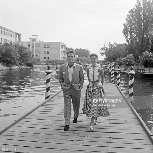 Irich actor Richard Todd and British actress Janette Scott walking on a jetty during the XVI Venice International Film Festival Venice 1955