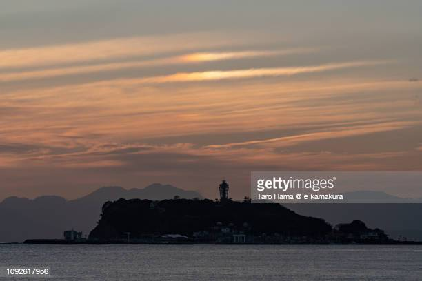 Iridescent clouds on Enoshima Island and Sagami Bay, Pacific Ocean in Japan