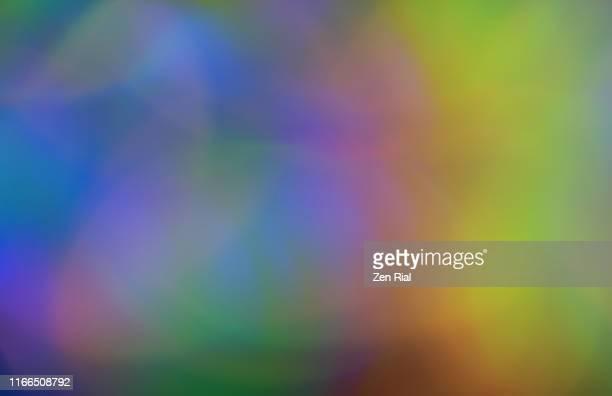 iridescent multicolored plastic ribbon close-up and defocused - 玉虫色 ストックフォトと画像