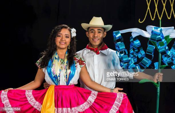 Iridiana Gomez and Oscar Velasco Putla de Guerrero pose during a rehearsal for the Guelaguetza traditional festival in Oaxaca Mexico on July 29 2018...