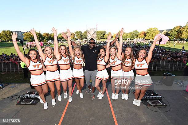 Irie poses onstage with Virginia Tech Cheerleaders at the PINK Nation Campus Party hosted by Victoria's Secret PINK at Virginia Tech on October 18...
