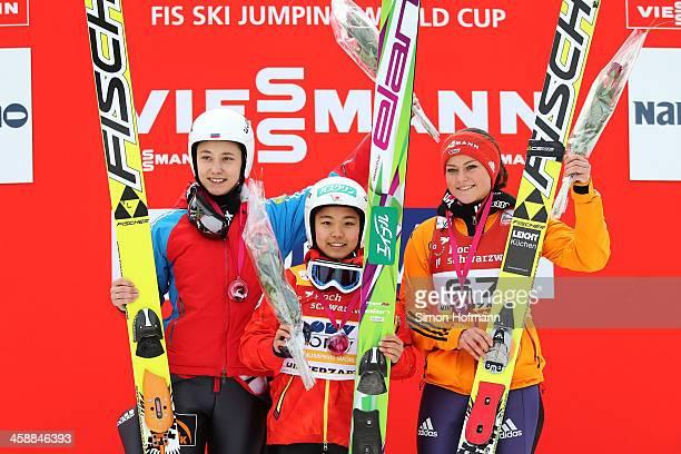 Irina Avvakumova of Russia, Sara Takanashi of Japan and Carina Vogt of Germany celebrate during the winners' ceremony at the Ladies Ski Jumping HS...