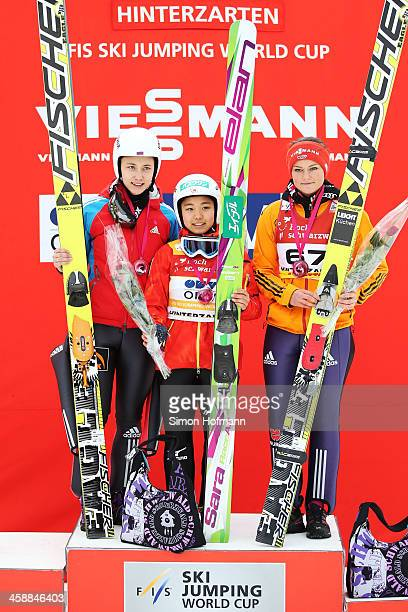 Irina Avvakumova of Russia, Sara Takanashi of Japan and Carina Vogt of Germany pose during the winners' ceremony at the Ladies Ski Jumping HS 108...