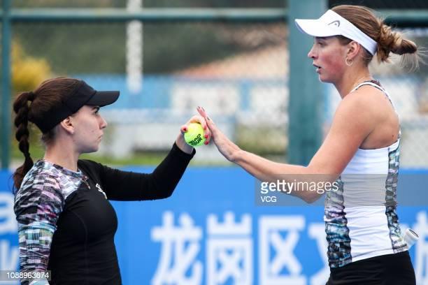 Irina Bara of Romania high five Oksana Kalashnikova of Georgia during the women's doubles quarterfinal match against Peng Shuai of China and Yang...
