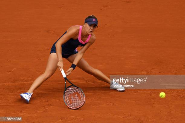 Irina Bara of Romania plays a backhand during her Women's Singles third round match against Sofia Kenin of The United States of America on day seven...