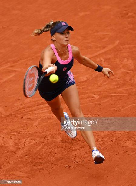 Irina Bara of Romania plays a forehand during her Women's Singles third round match against Sofia Kenin of The United States of America on day seven...