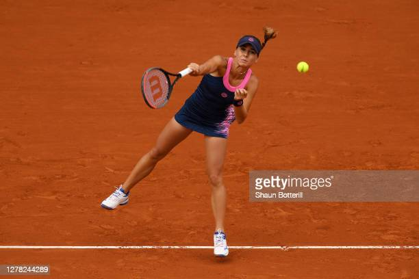 Irina Bara of Romania serves during her Women's Singles third round match against Sofia Kenin of The United States of America on day seven of the...