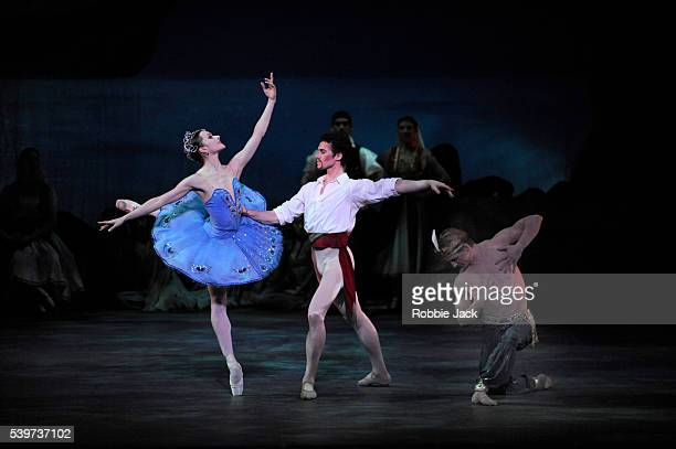 Irina Dvorovenko as MedoraCory Stearns as Conrad and Ethan Stiefel as Ali with artists of the company in American Ballet Theatre's production of Le...