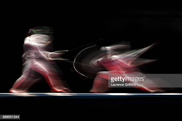 Irina Embrich of Estonia competes against Lyubov Shutova of Russia during the Women's Epee Team Bronze Medal Match bout on Day 6 of the 2016 Rio...