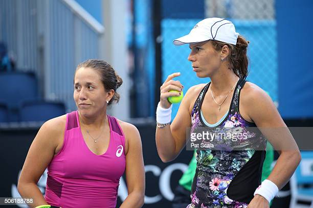 Irina Falconi and Varvara Lepchenko of the United States talk tactics during their second round doubles match against Anabel Medina Garrigues and...
