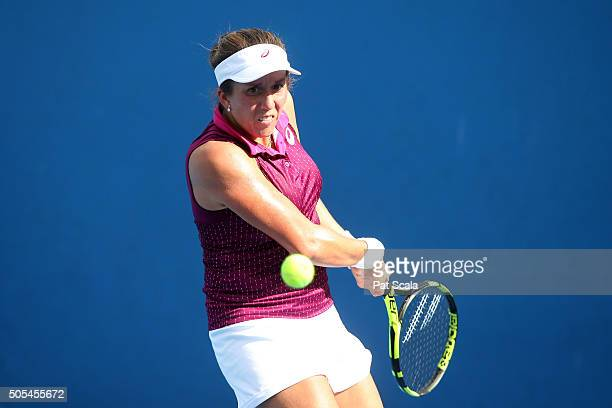 Irina Falconi of the United States plays a backhand in her first round match against Anna Tatishvili of the United States during day one of the 2016...