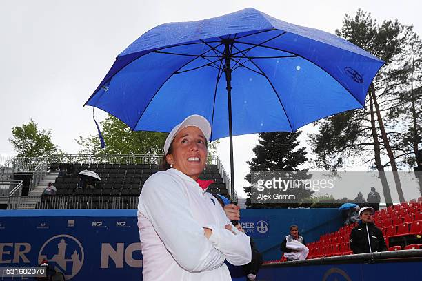 Irina Falconi of USA waits in the rain for her match against Katharina Gerlach during Day Two of the Nuernberger Versicherungscup 2016 on May 15 2016...