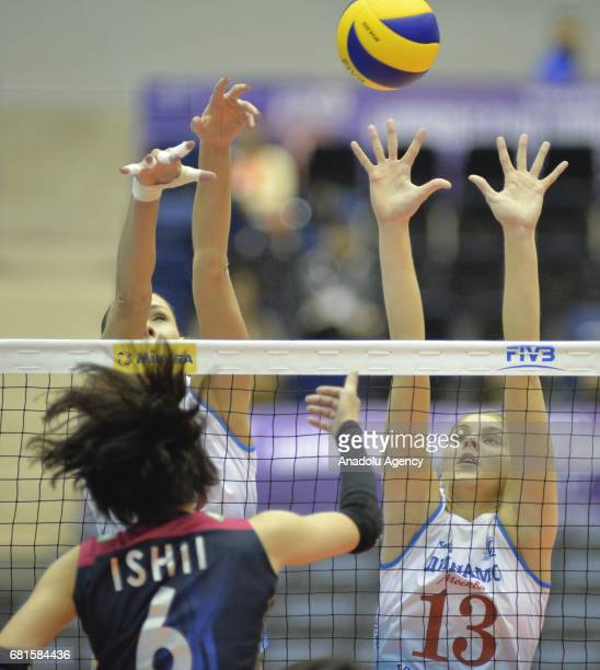 Irina Festisova of Dinamo Moscow in action against Yuki Ishii of Hisamitsu Spring during the pool match of the FIVB Womens Club World Championship...