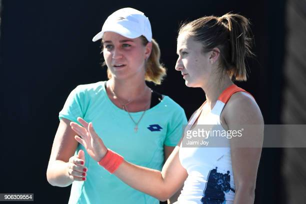 Irina Khromacheva of Russia and Dalila Jakupovic of Slovenia talk tactics in their first round women's doubles match against Alison Riske of the...