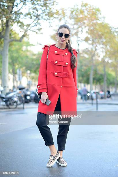 Irina Koslovan poses wearing a Moschino coat and Saint Laurent shoes on September 25, 2014 in Paris, France.