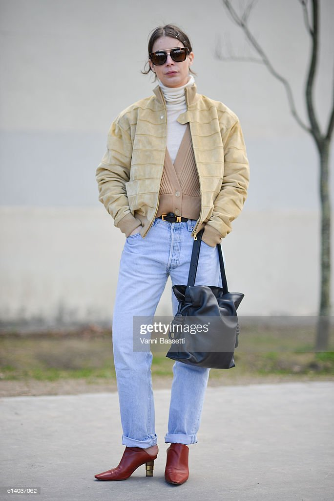 Irina Lakicevic poses wearing a Loewe jacket and bag and Celine shoes after the Celine show at the Tennis Club de Paris show during Paris Fashion Week FW 16/17 on March 6, 2016 in Paris, France.
