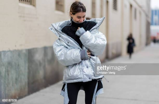 Irina Lakicevic wearing a silver down feather jacket outside Proenza Schouler on February 13 2017 in New York City