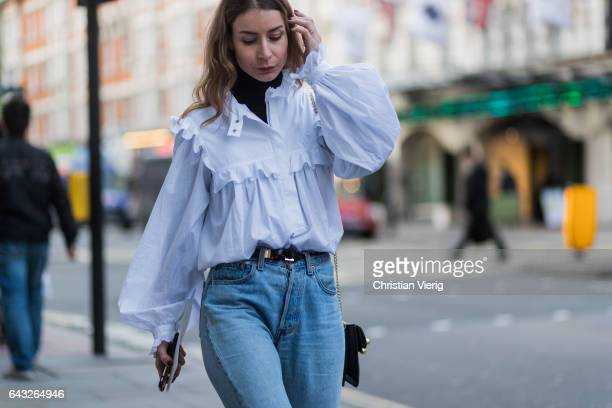 Irina Lakicevic wearing a white top denom jeans outside Joseph on day 4 of the London Fashion Week February 2017 collections on February 20 2017 in...