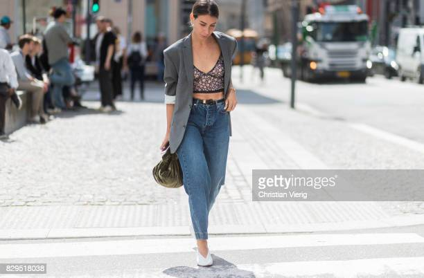 Irina Lakicevic wearing croped flared denim jeans, blazer outside Baum Und Pferdgarten on August 10, 2017 in Copenhagen, Denmark.
