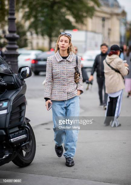 Irina Lakicevic wearing denim boyfriend jeans tweed blazer is seen outside Chanel during Paris Fashion Week Womenswear Spring/Summer 2019 on October...