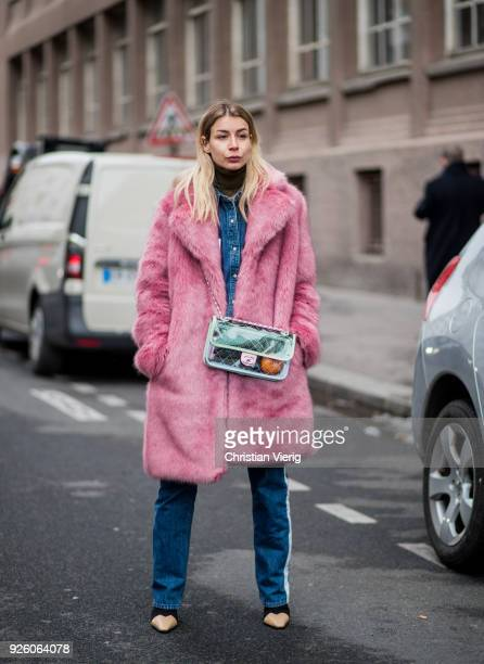 Irina Lakicevic wearing see through Chanel bag pink teddy coat is seen outside Carven on March 1 2018 in Paris France