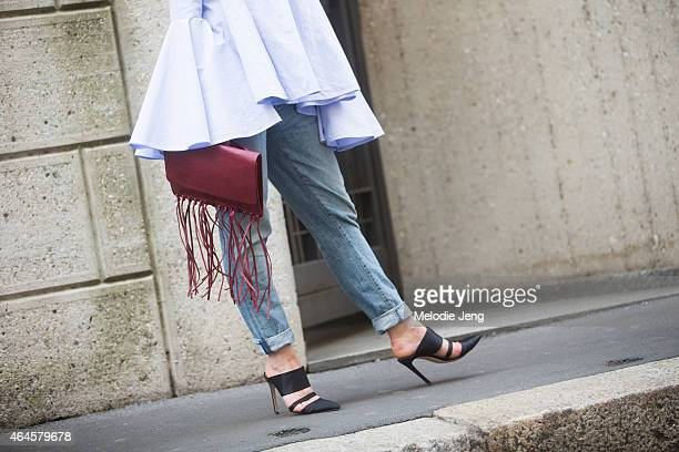 Irina Lakicevic wears an Ellery top Levi's jeans Altuzarra shoes and a By Malene Birger bag on February 26 2015 in Milan Italy